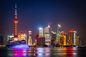 Shanghai glittering neon skyscrapers of Pudong illuminated at night China