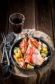 Roasted pheasant with bacon and vegetables and spices