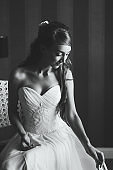 Beautiful black and white portrait of young woman in wedding dress