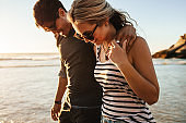 Happy young couple on beach holiday