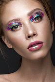 Beautiful girl with creative colorful makeup. Beauty face.