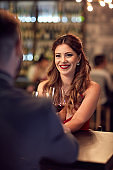 Elegance woman at restaurant with male