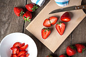 Strawberry on chopping wooden board