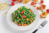 Green beans salad with Red, Yellow Tomatoes, bruschettas and flaked