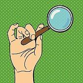 Pop art hand magnifying glass vector illustration