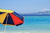 Minna beach and beach umbrella in Minna island, Okinawa, Japan