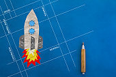 wooden pencil with paper rocket creativity ideas concept