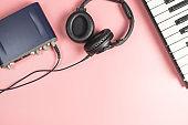 Portable Music Studio equipment on pink background