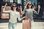 Girls doing shopping in city