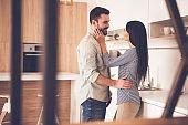 Beautiful couple in kitchen