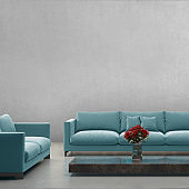 Modern blue pastel sofa in front of blank gray wall - interior copy space template