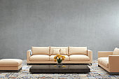Modern orange pastel sofa in front of blank gray wall - interior copy space template