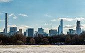 New York City skyline through Central Park's interior