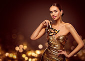 Woman Mask, Fashion Model Face with Golden Carnival Mask, Beauty Gold Dress