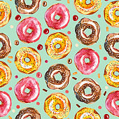 watercolor illustration. Seamless pattern of colorful donut and candy on mint background