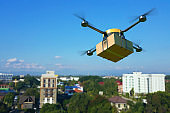 Delivery drone with the cardboard box.