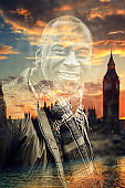 Double exposure portrait of an afro american man with the Big Ben in London