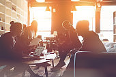Silhouette of business people meeting in office