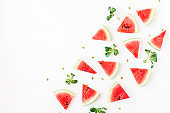 Sliced watermelon on white background. Flat lay, top view