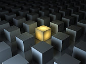 Stand out from the crowd and different creative idea concepts , One glowing yellow light cube among other dim cubes on dark gray background with reflections and shadows . 3D render