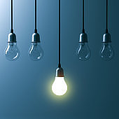 One hanging light bulb glowing different and standing out from unlit incandescent bulbs with reflection on dark cyan background , leadership and different business creative idea concept. 3D render