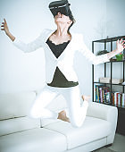 Women testing Virtual Reality simulator at home
