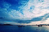 Serene beach and ship at sunrise in Sabah,Malaysia