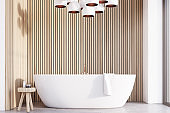 Bathroom with lamps, light wood, front
