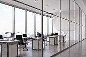 Open office seen through glass wall