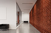 Office corridor with brick walls