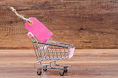 Blank pink paper price tag with shopping cart
