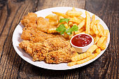 plate of fried chicken with french fries