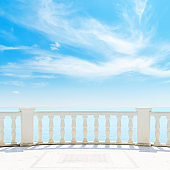clouds and blue sky over white balcony