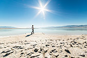 The young man, hipster and traveler, exploring the Great Salt Lake, Utah
