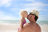 Father Kissing his Baby Daughter on the Beach
