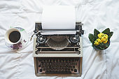 Vintage typewriter on  the bed, top view