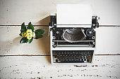 Vintage typewriter on  wooden background