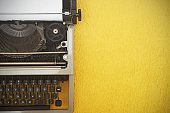 Vintage typewriter on  yellow background