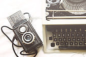 Vintage typewriter and camera on  white background.