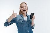 Cheerful blonde showing her thumb