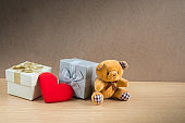 Bear doll with gift boxes and red heart