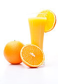 One orange and a half near a glass of orange juice