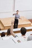 Teacher standing explaining