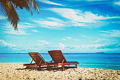 Two chairs on tropical beach