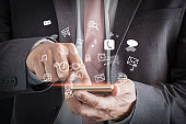 Businessman playing on the digital mobile device with social media icons