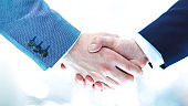Businessmen shaking hands, isolated on white