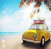 Start summertime vacation with an old car on the beach. 3d rendering