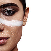Fashion beauty female Model with white Paint Strip