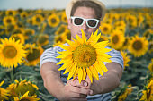 Man holding sunflower