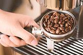 Roasted coffee bean in a portafilter